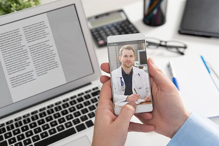 patient having a video call with the doctor over the phone