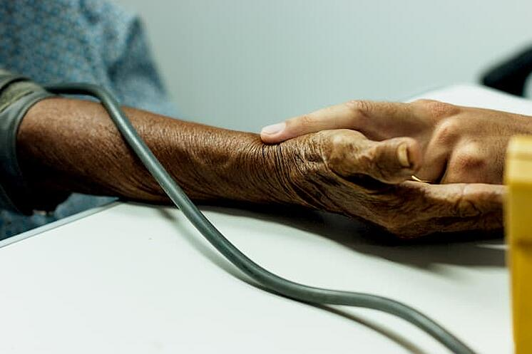 doctor checking the pulse of a patient