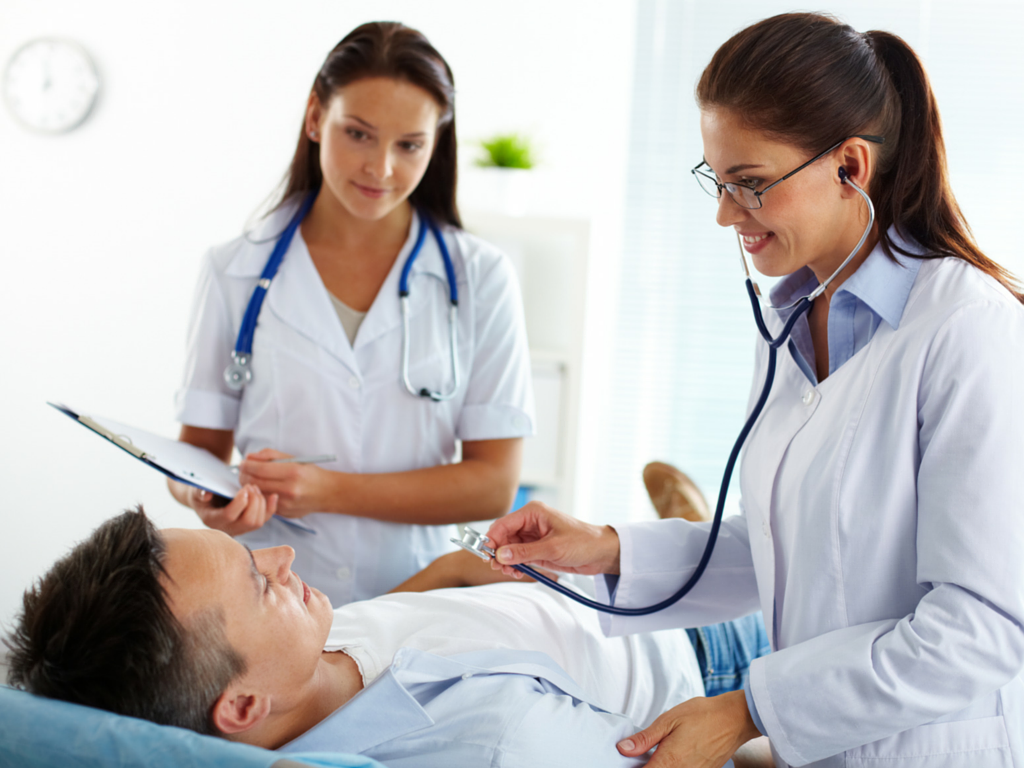 Healthcare consumer and physicians in a hospital setting