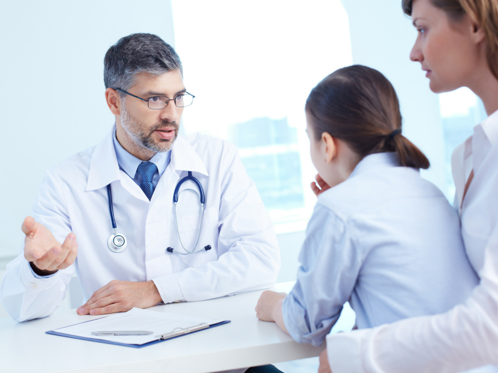Physician consulting with healthcare consumers