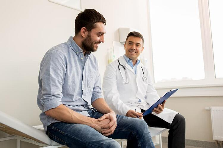 Patient sitting with their doctor
